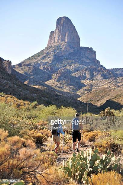 man and woman backpackers hike on the popular peralta trail in the superstition wilderness area, tonto national forest near phoenix, arizona november 2011. - phoenix arizona stock photos and pictures