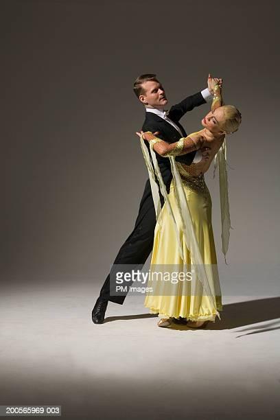 Man and woman ballroom dancing