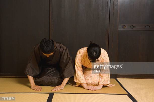 Man and woman bowing