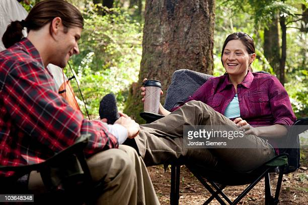 Man and woman camping in the wilderness.
