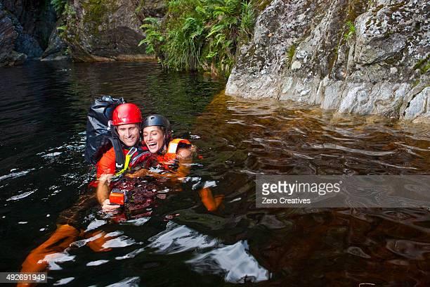 Man and woman canyoneering
