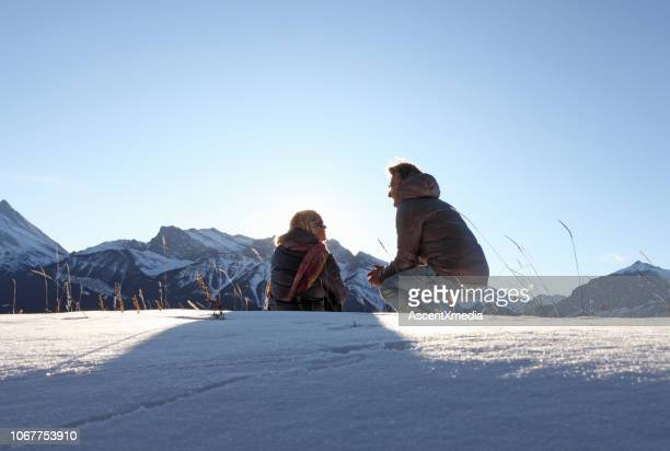 Man and woman chat in the snow