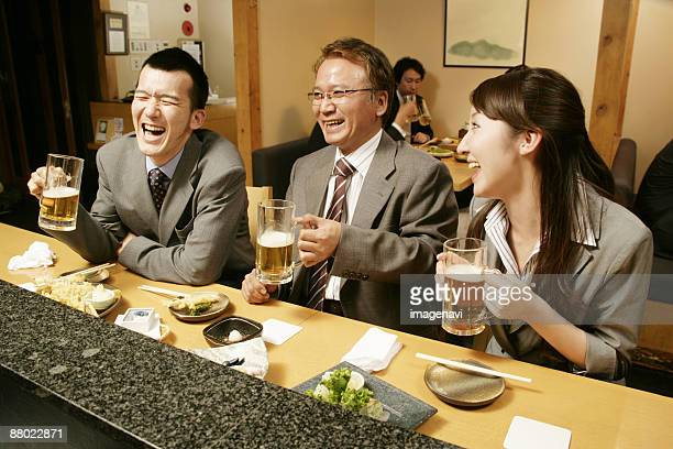 man and woman chatting in the japanese-style pub - catering building stock pictures, royalty-free photos & images
