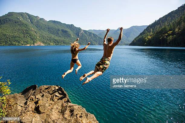 Man and woman cliff jumping