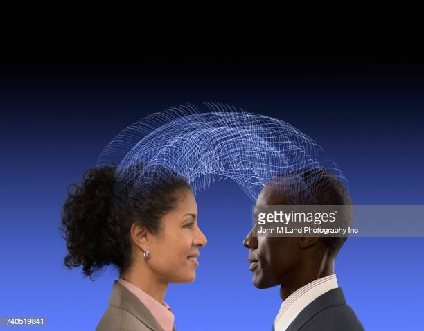 man and woman communicating using telepathy - telepathy stock pictures, royalty-free photos & images