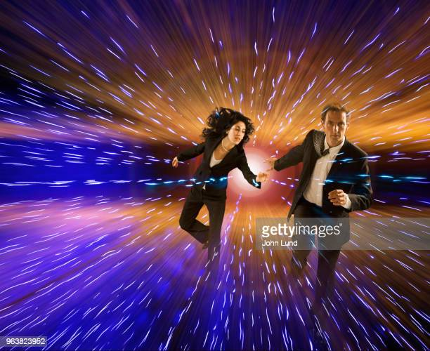 man and woman couple fleeing future technology - eskapismus stock-fotos und bilder