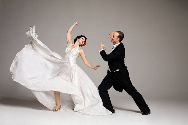 man and woman dancing in 1920's style clothing