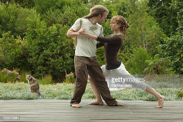 Man and woman dancing outdoors