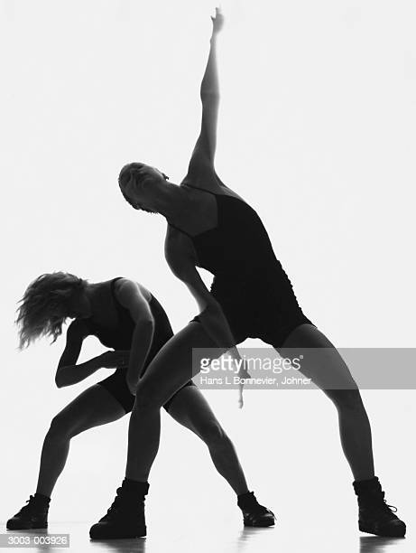 man and woman dancing - man bending over from behind stock photos and pictures