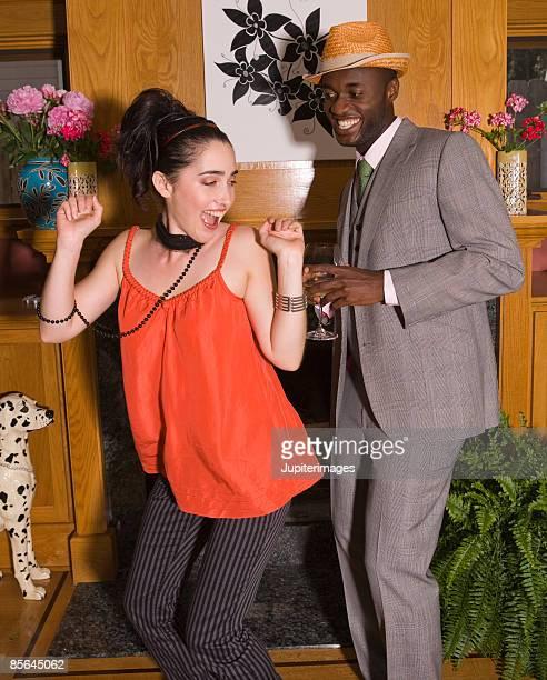 man and woman dancing - グレンチェック ストックフォトと画像