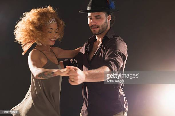 Man and woman dancing salsa