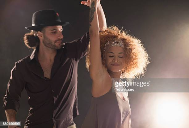 man and woman dancing salsa - salsa dancing stock photos and pictures