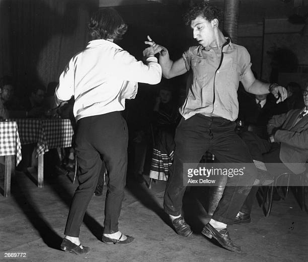 A man and woman dancing the jitterbug Original Publication Picture Post 7307 A A Club unpub