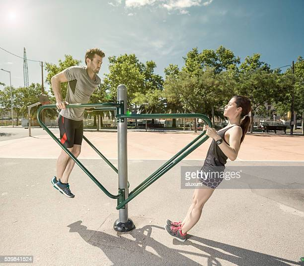 Man and woman doing exercises in the city