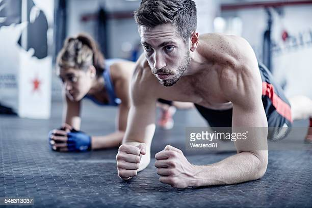 Man and woman doing fitness training