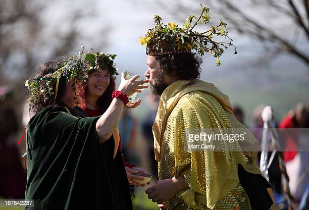 A man and woman dressed to represent the May King and Queen drink as they take part in a Beltane May Day celebration below Glastonbury Tor on May 1...