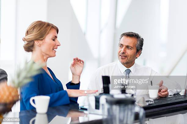 Man and woman drinking coffee and talking