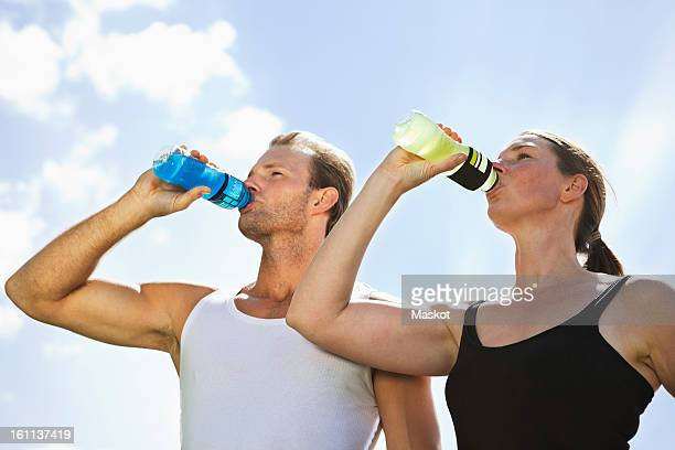 Man and woman drinking sport drink
