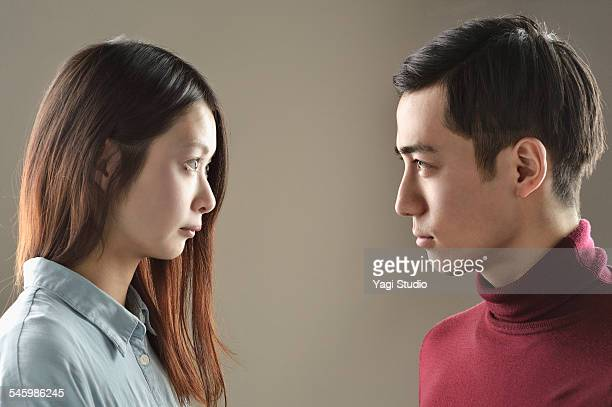 Man and woman each other staring to face to face