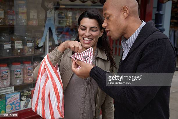 Man and woman eating candy