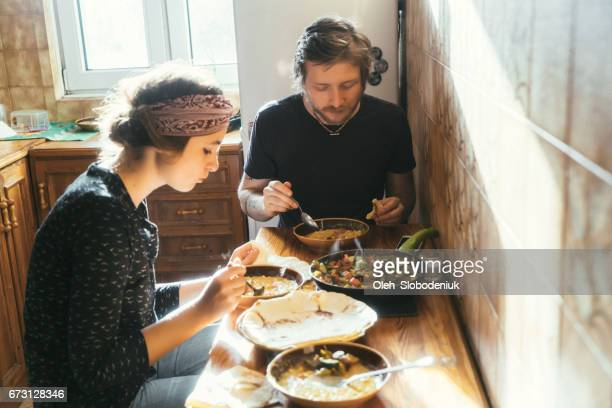 Man and woman eating home-made food