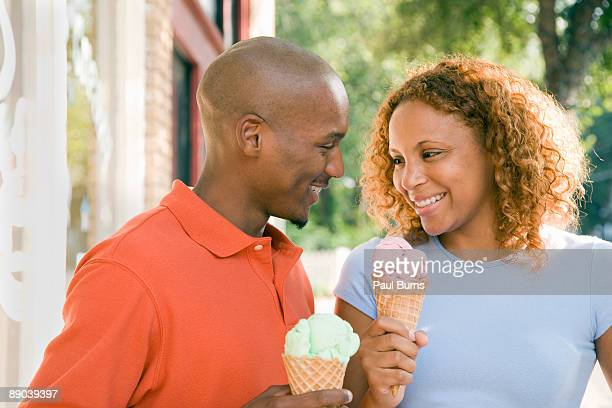 Man and Woman Eating Ice Cream in Waffle Cones