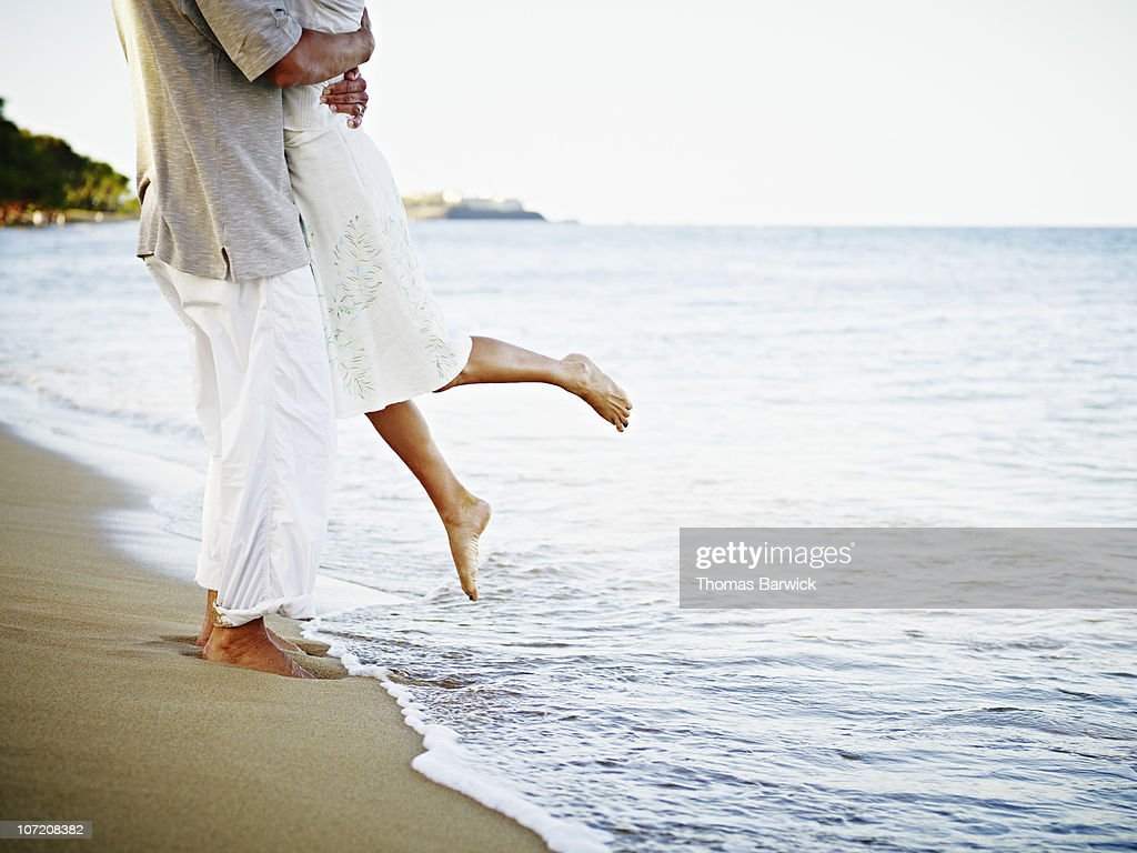 Man and woman embracing on tropical beach : Stock Photo