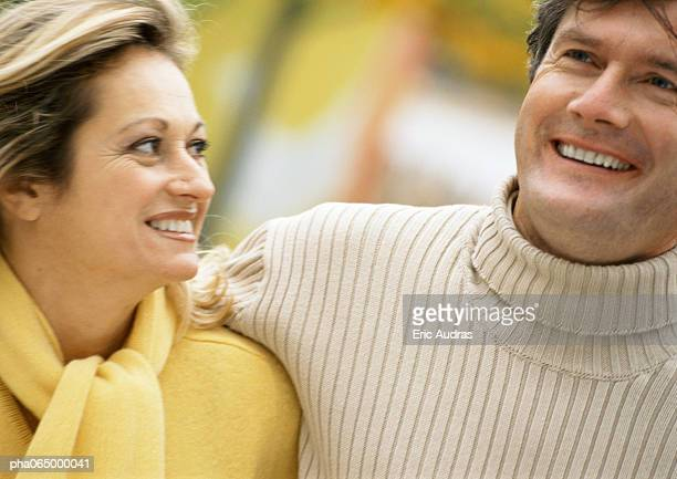 man and woman embracing, smiling, head and shoulders, out of frame,  close-up - out of frame stock pictures, royalty-free photos & images