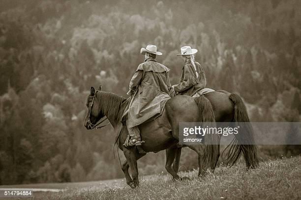 Man and woman enjoying horse riding