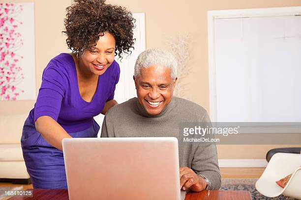 Man and woman enjoying the computer together