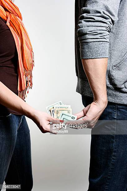 Man and Woman Exchaning Wad of Money