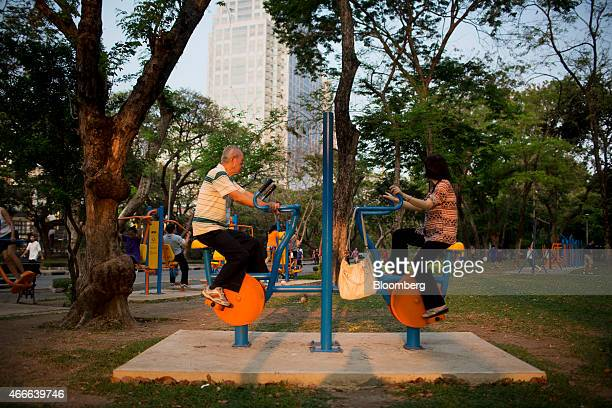A man and woman exercise at Lumphini Park in Bangkok Thailand on Sunday March 15 2015 Almost a third of Thailand's population will be over 60 by 2050...