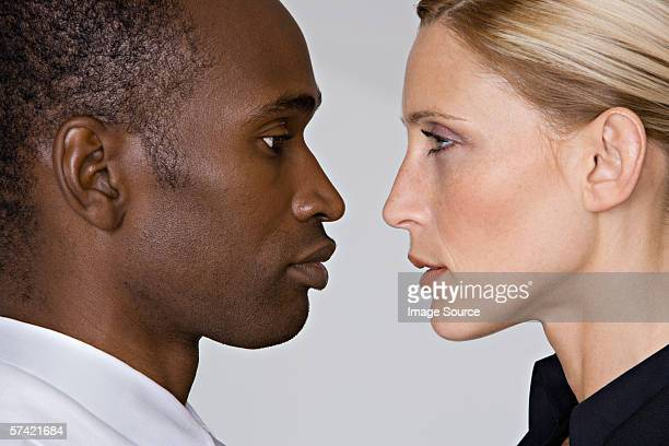 man and woman face to face - confrontation stock pictures, royalty-free photos & images