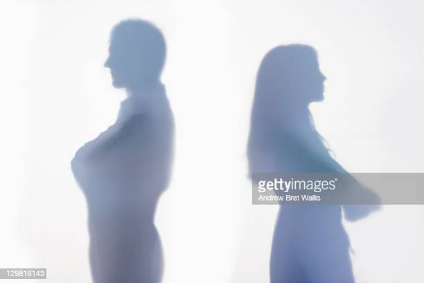 man and woman facing away in a stand-off
