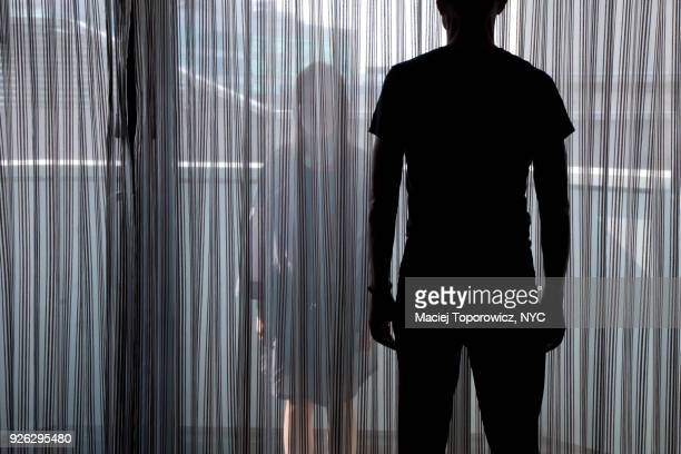 man and woman facing each other on balkony. - stranger stock pictures, royalty-free photos & images