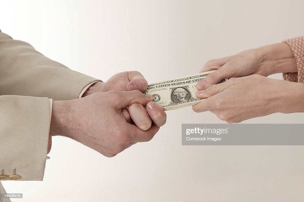 Man and woman fighting for money : Stock Photo