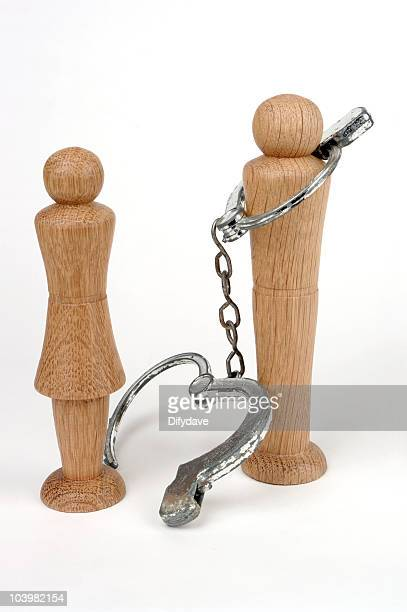 Man And Woman Figures With Handcuffs