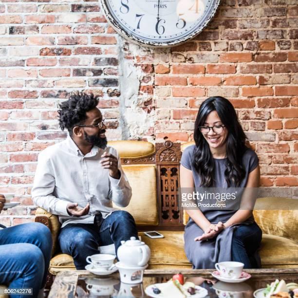 Man and woman flirting in tea shop