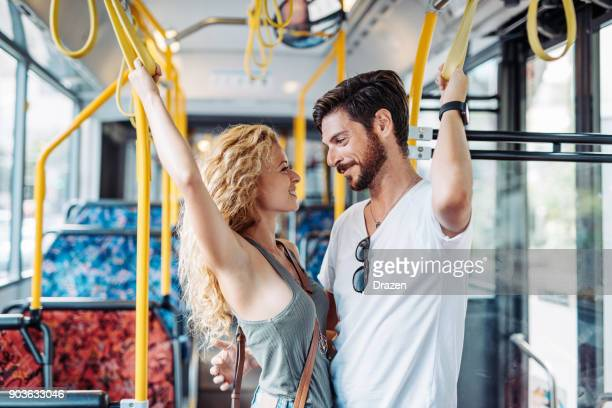 Man and woman flirting in the bus during the ride