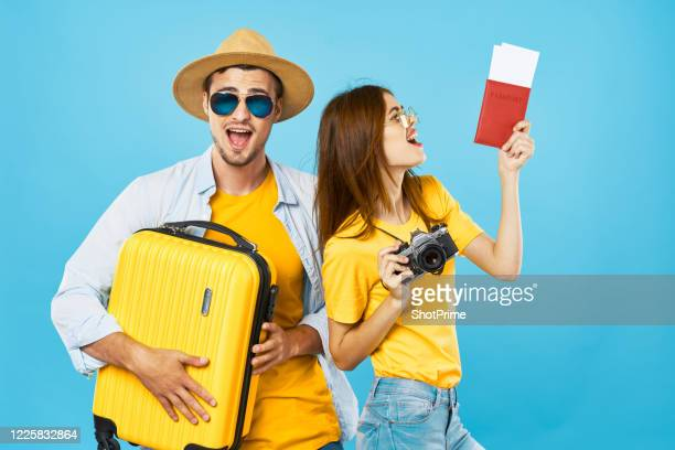 man and woman get a green card and go on a trip. - ticket stock pictures, royalty-free photos & images