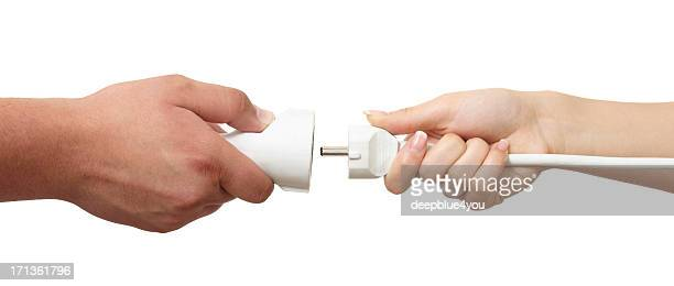 Man and woman hands holding European plug and outlet isolated