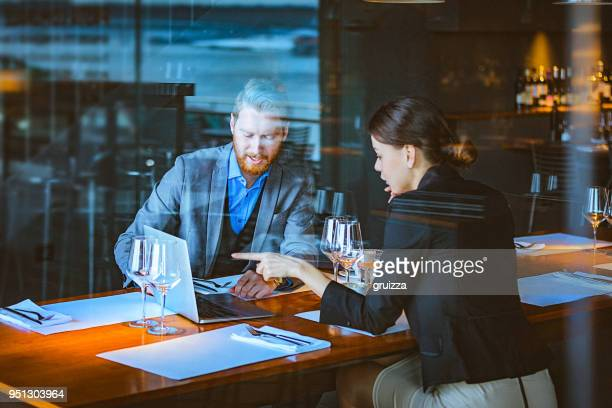 Man and Woman Having a Discussion During Lunch Time in a High-End Restaurant