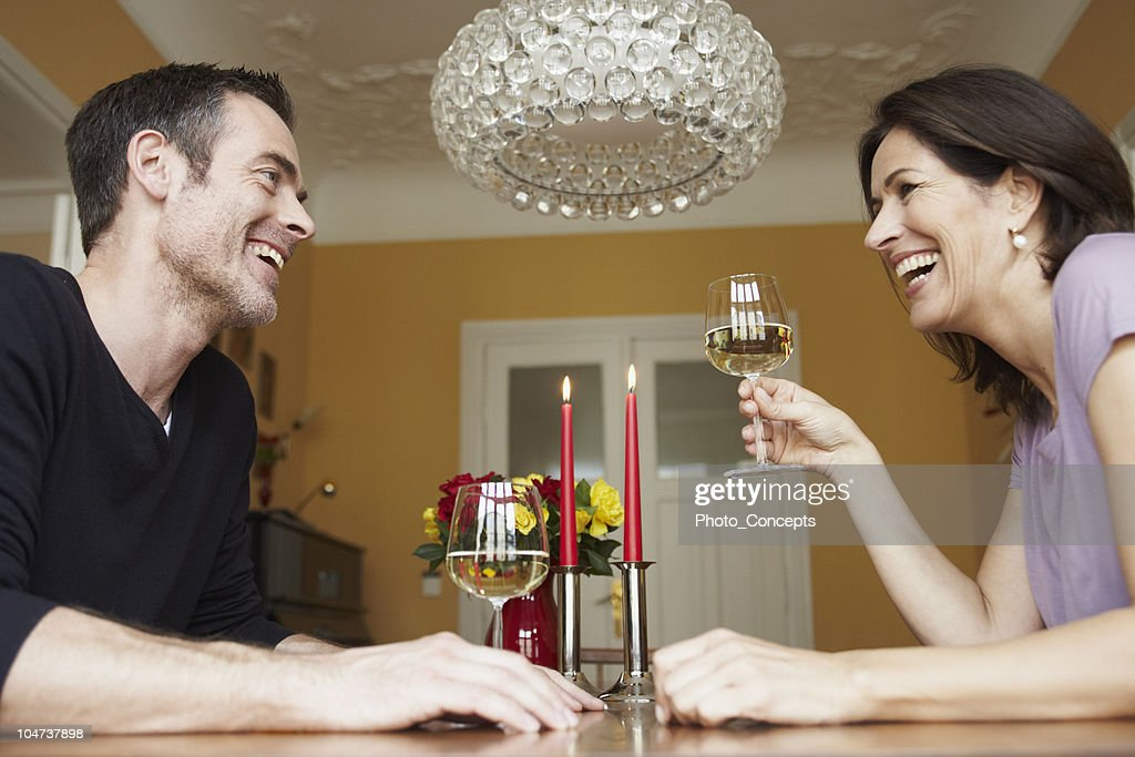 Man and woman having glass of wine : Stock Photo