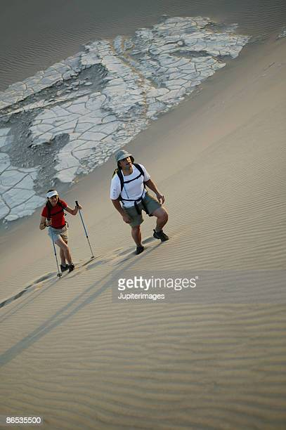 Man and woman hiking in desert