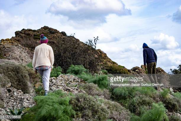 Man and Woman Hiking in Nature