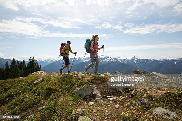 man and woman hiking outdoors - mountain ridge stock pictures, royalty-free photos & images