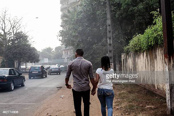 A man and woman hold hands on the street in Conakry Guinea on Tuesday January 20 2015