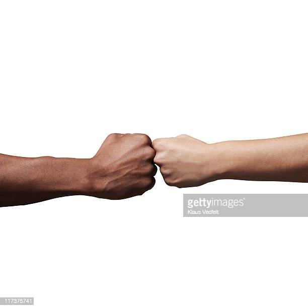 man and woman holding fists together - 拳 ストックフォトと画像