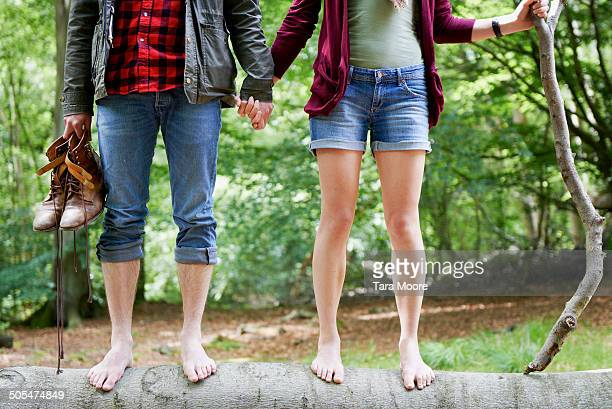 man and woman holding hands in forest - barefoot stock pictures, royalty-free photos & images