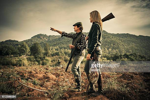 Man and woman hunting pheasants